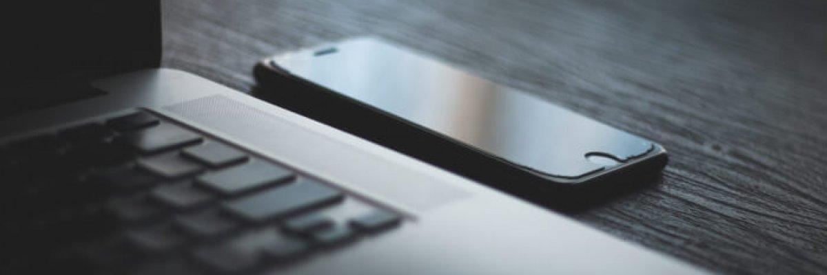 iphone-beside-laptop-computer-1350461